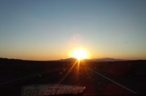 The sun sets on Route 66 The Mother Road west of Ludlow, California